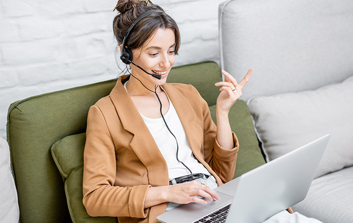 Young professional using headset while working from home